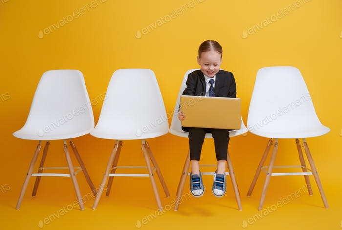 baby girl working on a computer