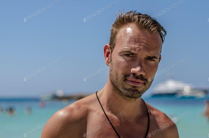 Shirtless man enjoying the beach