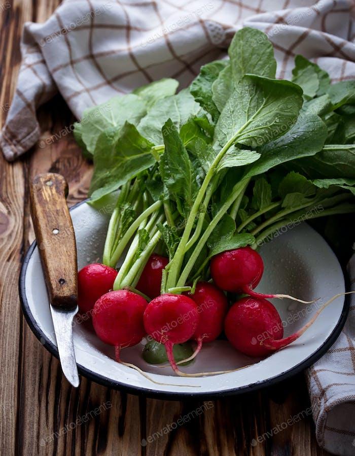 Fresh radishes and knife