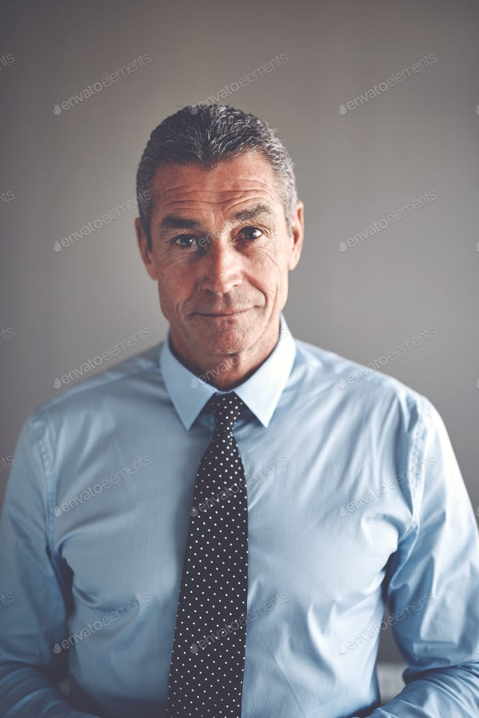 Focused mature businessman wearing a shirt and tie