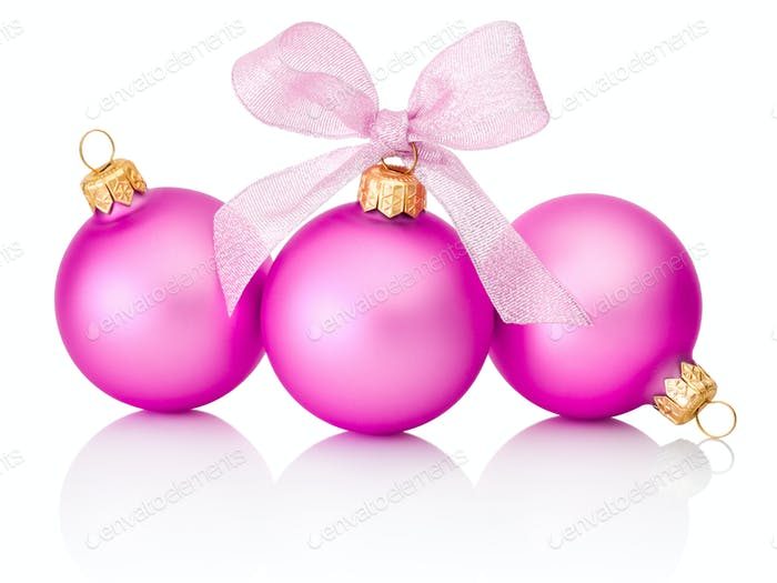 Three pink christmas balls with ribbon bow Isolated on white bac