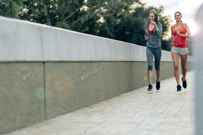 Active female joggers running outdoors