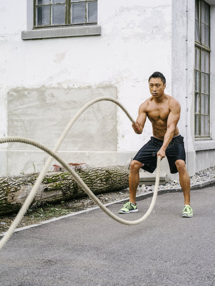 Workout outdoors with training ropes