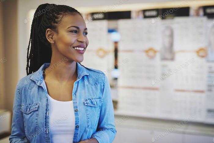 Smiling entrepreneur in her own shop