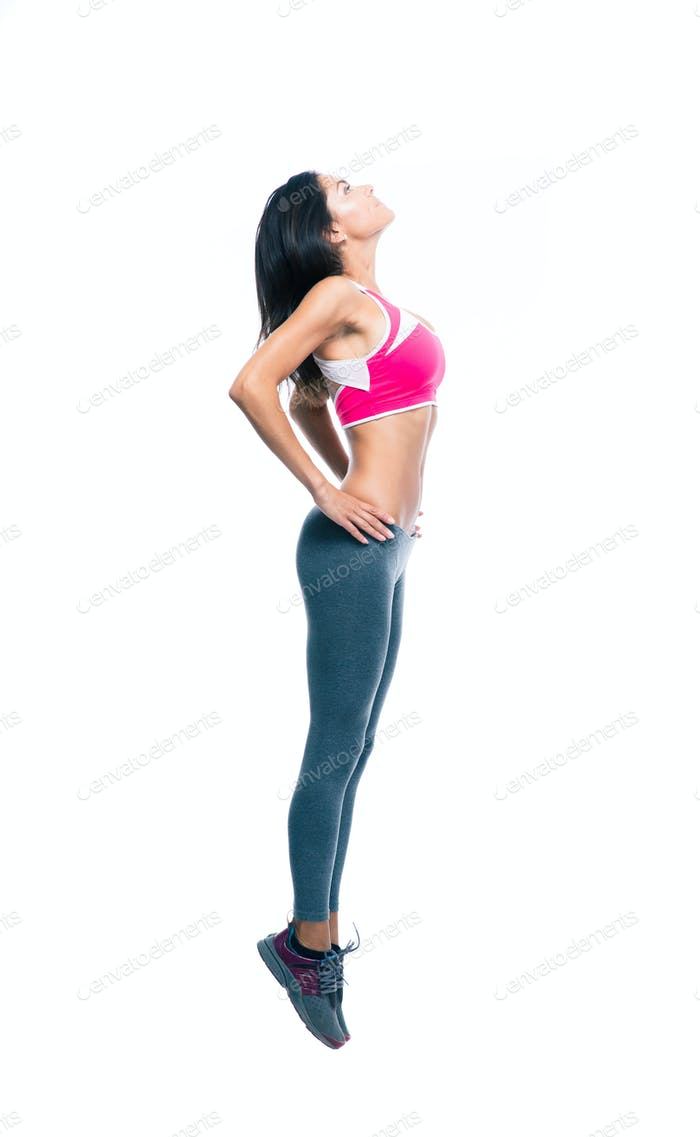 Full length portrait of a fitness woman stretching