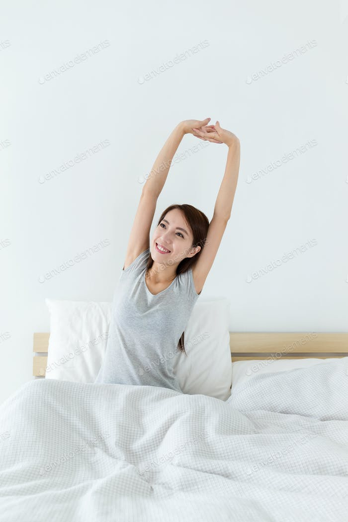 Woman just wakeup and raised hand up