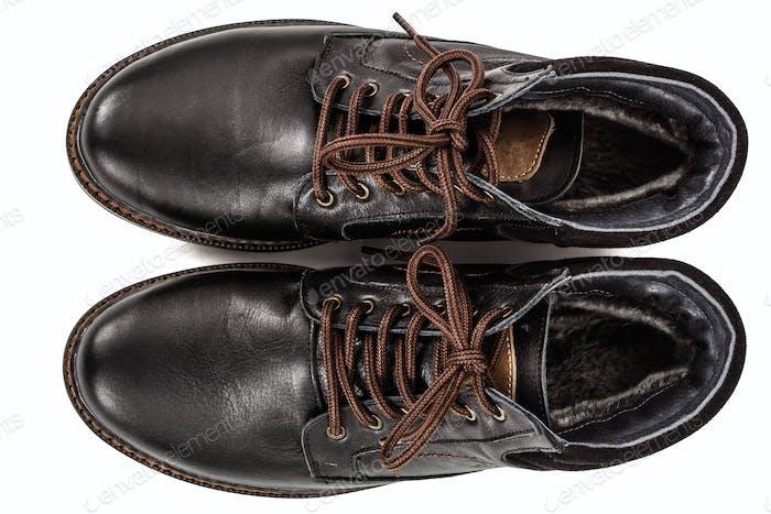 Paar neue Stiefel, isoliert auf weißem Hintergrund