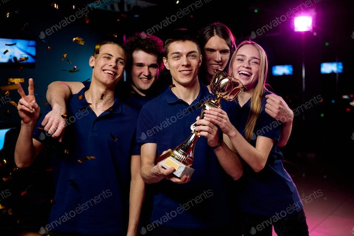 Team of excited teenage participants of e-sports video gaming competition