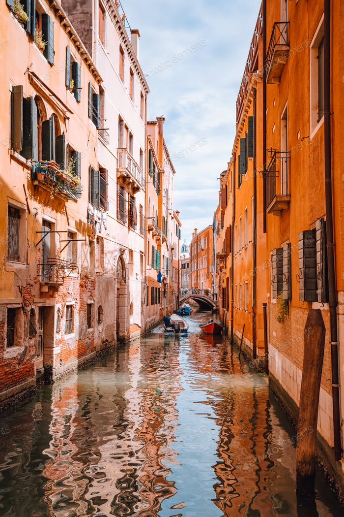 Venice, Italy. Beautiful view of the typical channels canals in Venezia. With small boat and