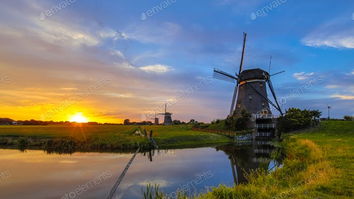 Three dutchwooden windmills