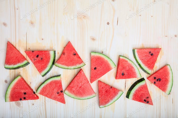 Watermelon pieces on a wooden board