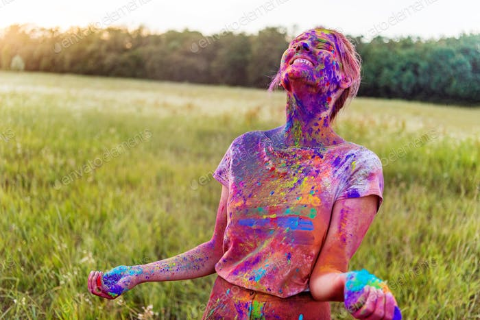 Young Woman Holding Colorful Paint