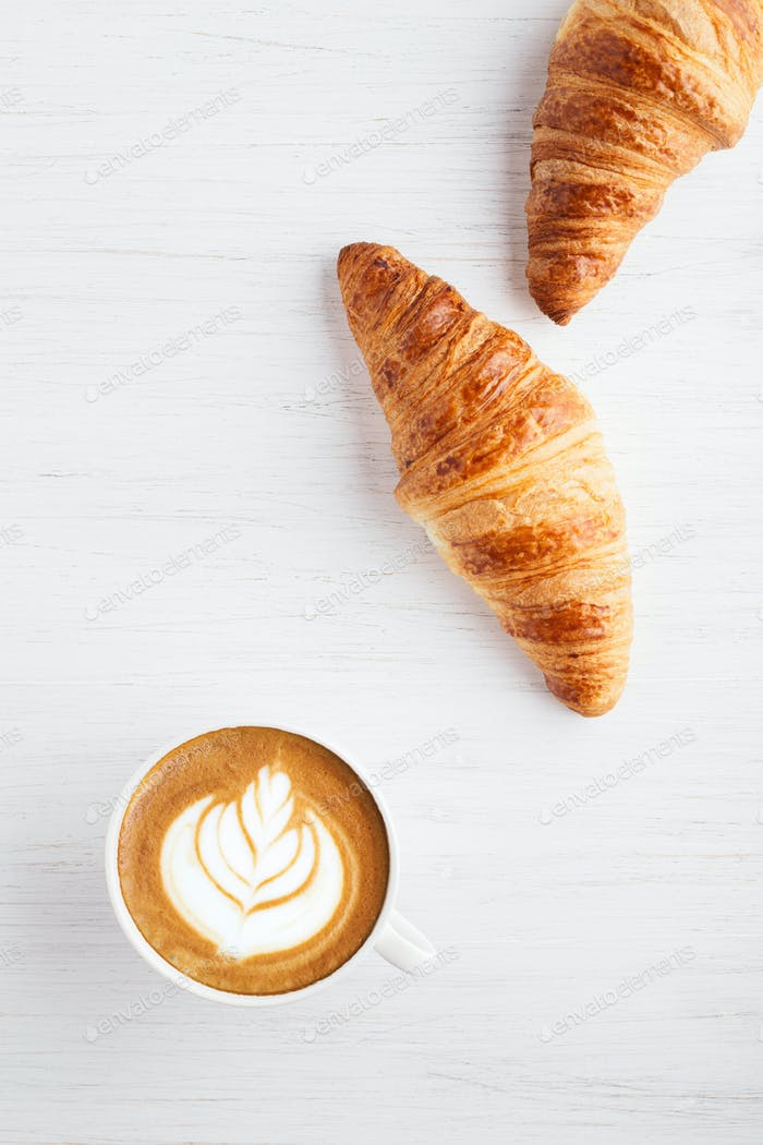 Two Croissants and a Cup of Cappuccino.