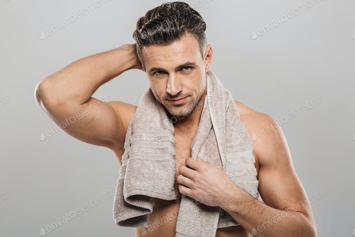 Handsome mature man holding towel.