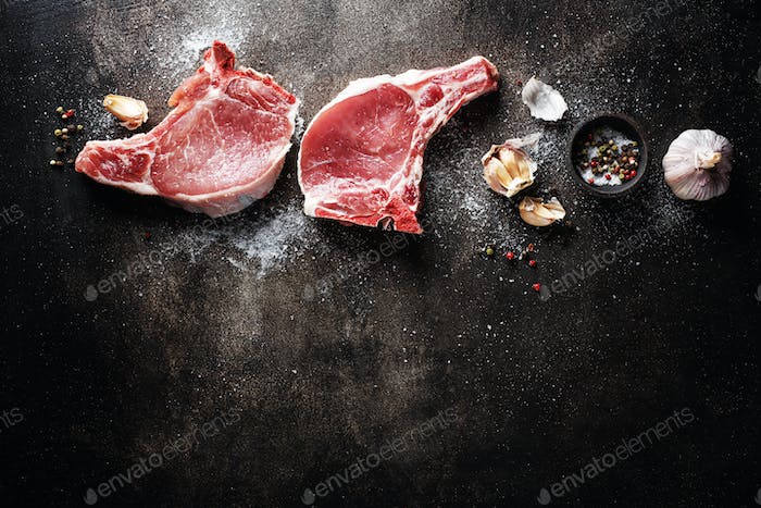 Raw meat with ingredients for cooking