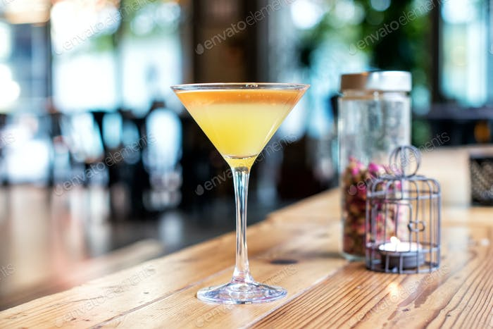Close-up of a yellow cocktail in a stemmed glass
