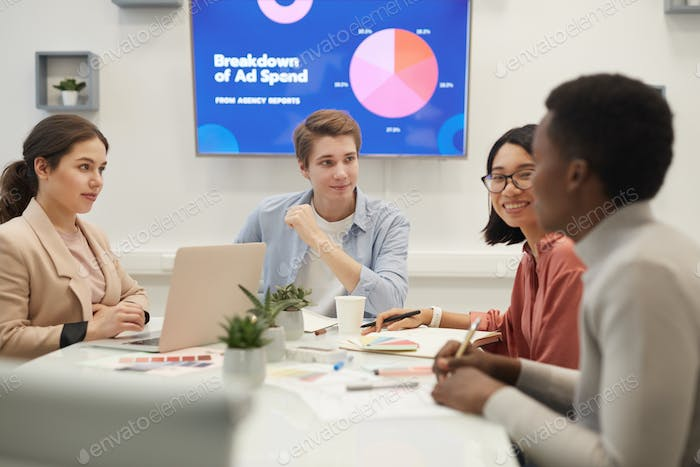 Young People Discussing Marketing in Meeting