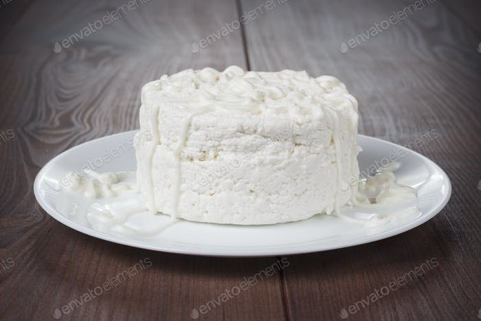 Cottage Cheese On Wooden Table