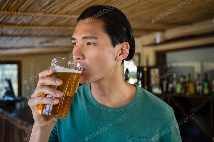 Thoughtful man drinking beer