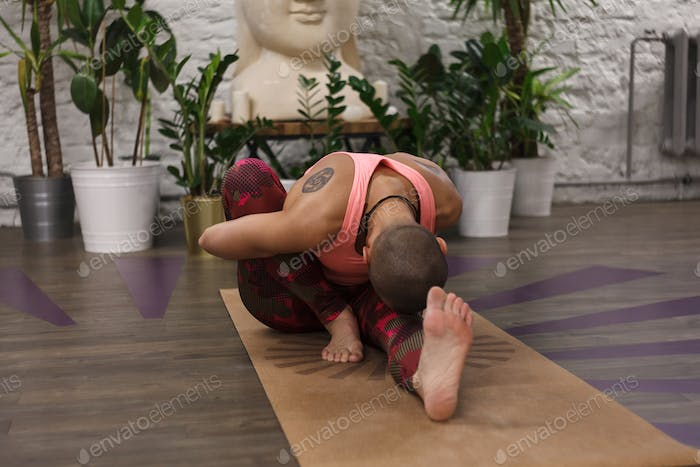 woman in sportswear doing asanas in yoga class