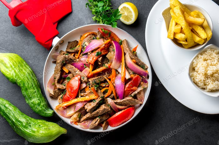 Peruvian dish Lomo saltado - beef tenderloin with vegetables