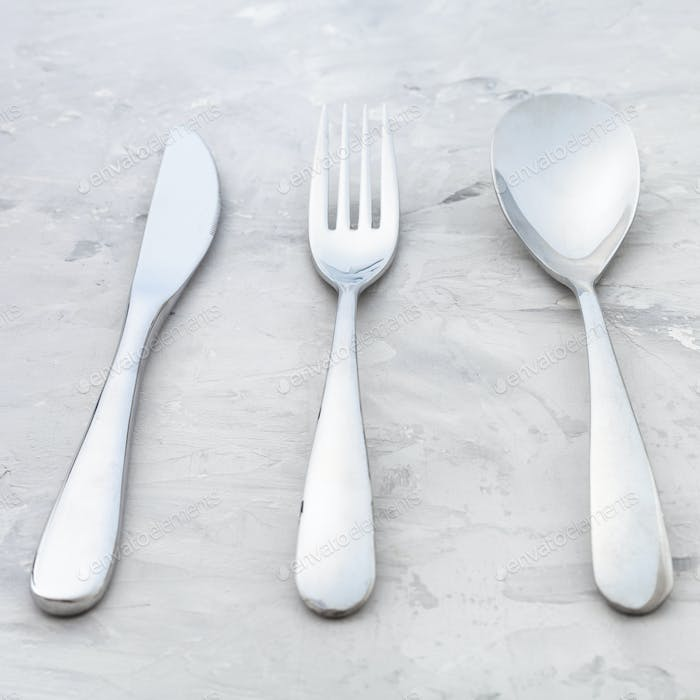 cutlery set from knife, fork, spoon on concrete