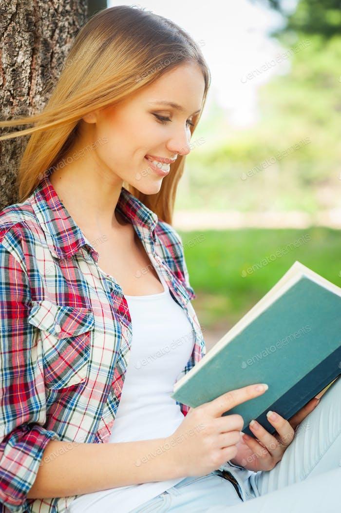 Enjoying book and fresh air.