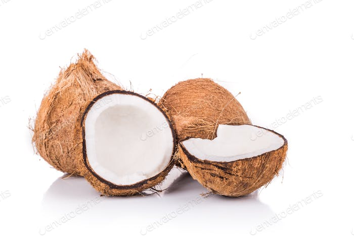 Old brown organic coconut fruits with one broken into half