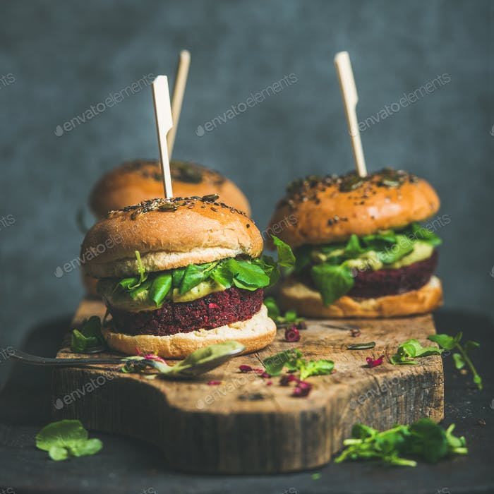 Healthy vegan burger with beetroot-quinoa patty and arugula, square crop