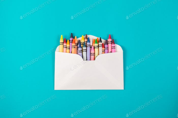 pencilics in the envelope on blue background top view
