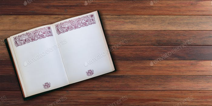 Open vintage book on wooden background - copy space