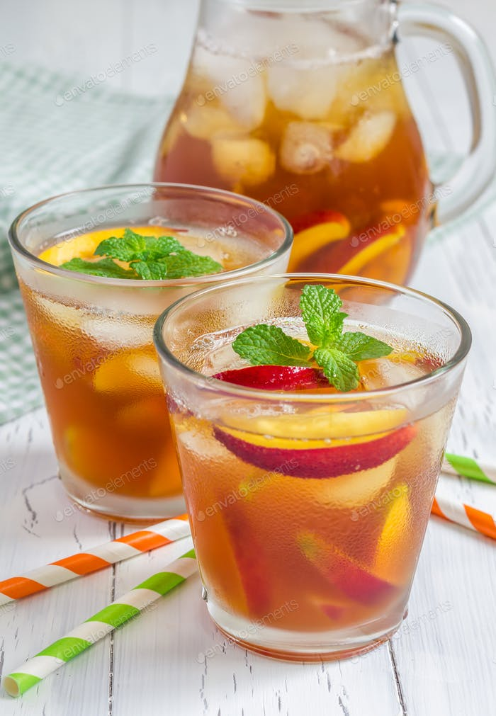 Two glasses of refreshing homemade nectarine iced tea