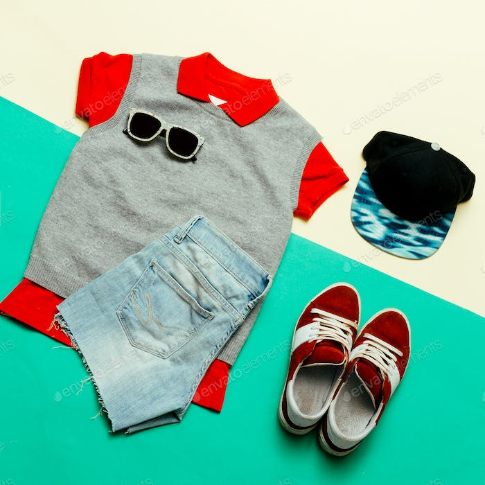 Stylish clothes. Skateboard fashion. Focus on red. Caps, Sneaker