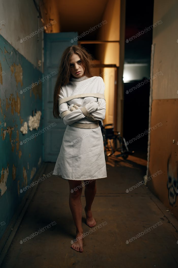 Female patient in straitjacket, mental hospital