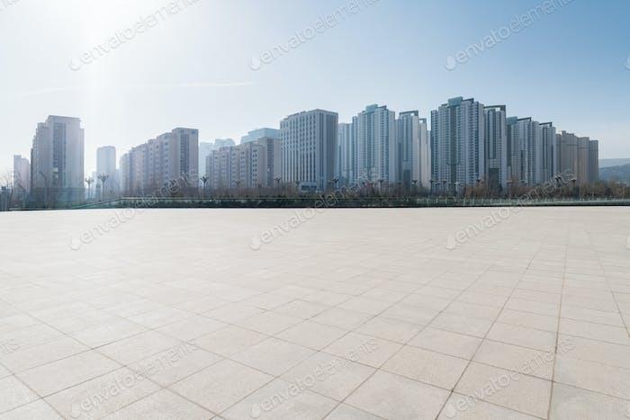empty brick floor with cityscape