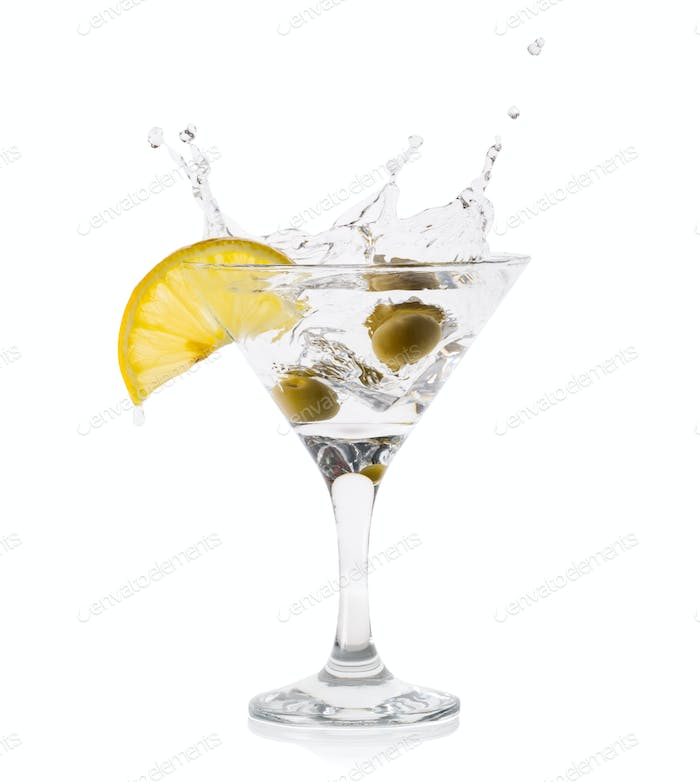 Martini splash with olives in a transparent glass