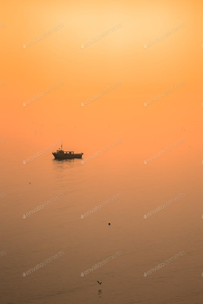 Fishing boat in Cornish bay at dusk