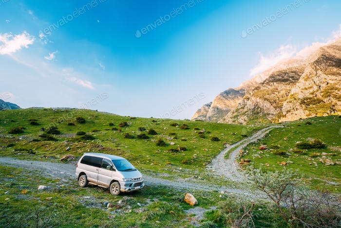 SUV Car On Off Road In Summer Mountains Landscape. Active Lifest