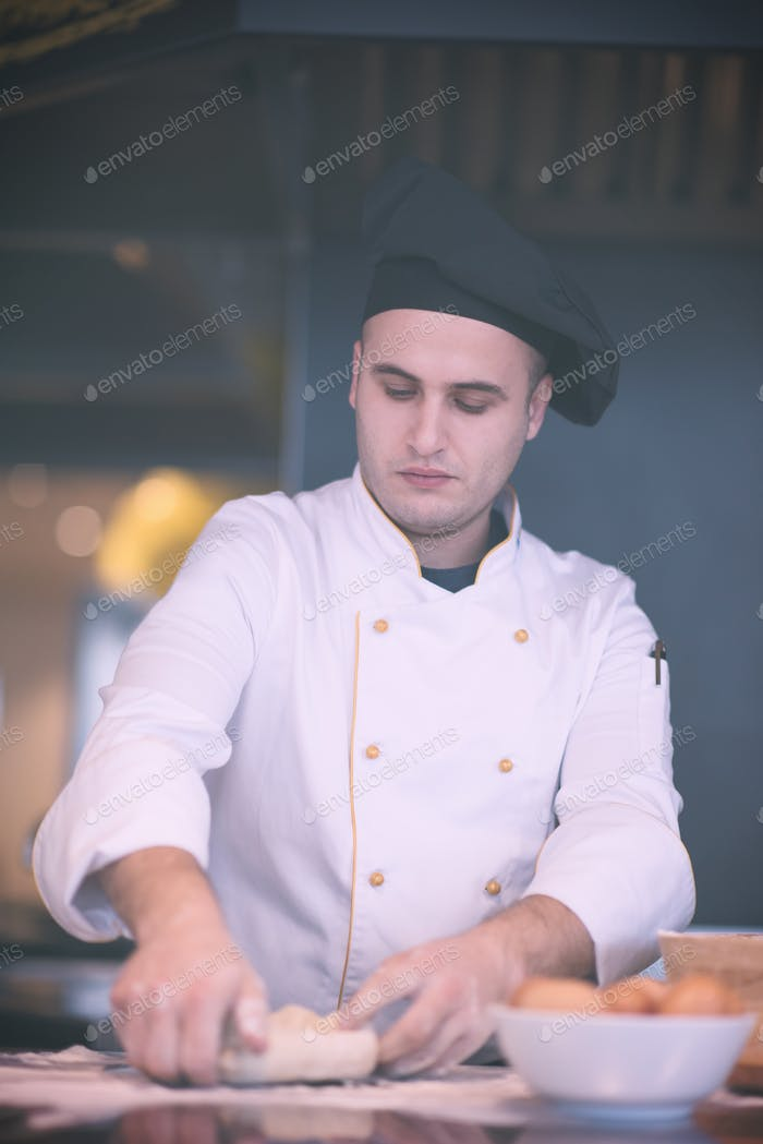 young chef preparing dough for pizza