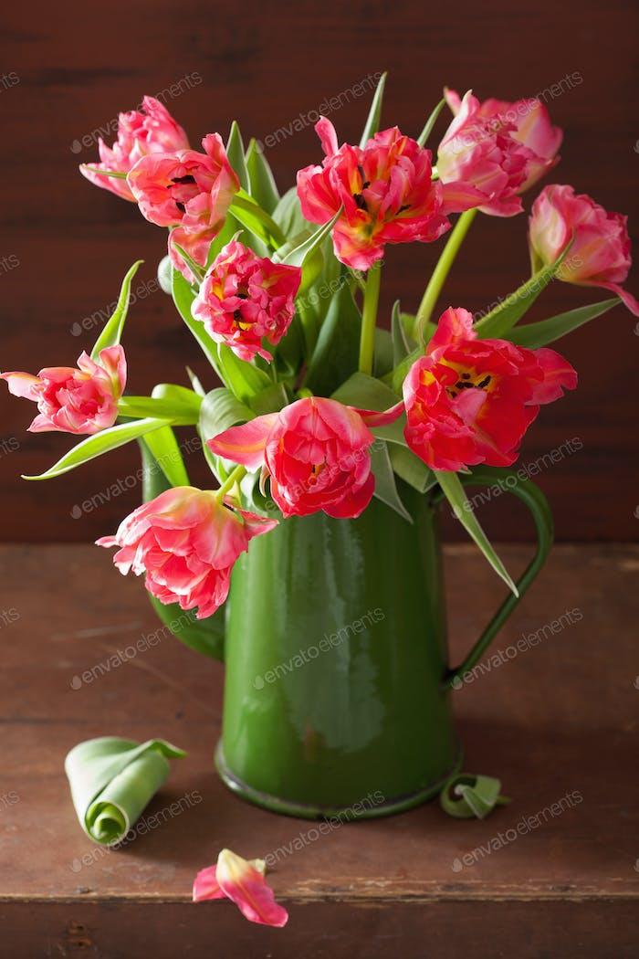 beautiful pink tulip flowers bouquet in green pot
