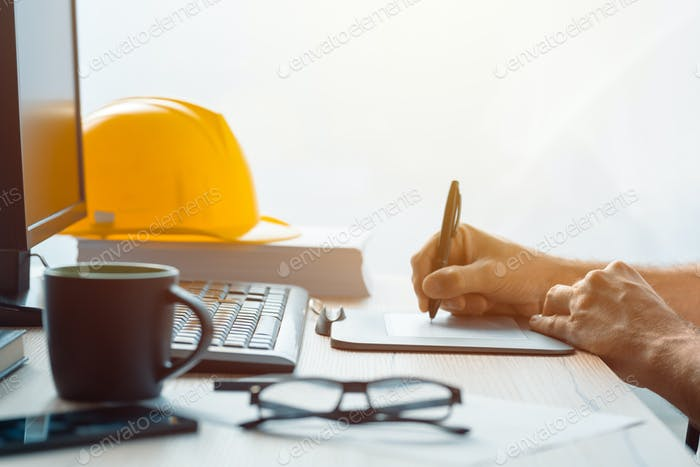 Architect construction engineer working with sketch pen tablet i