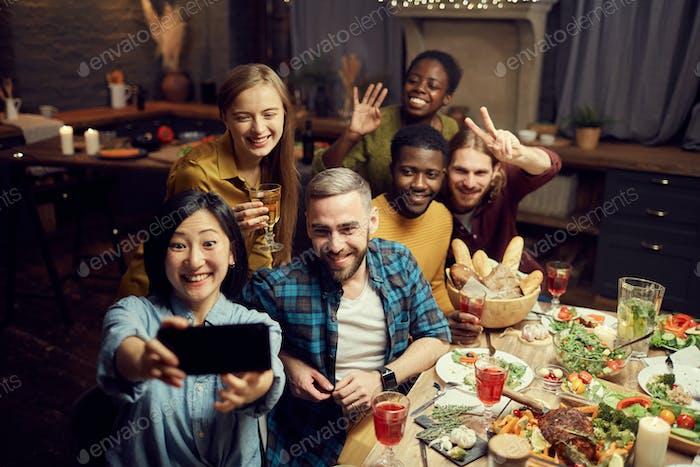 Friends Taking Selfie Photo at Dinner