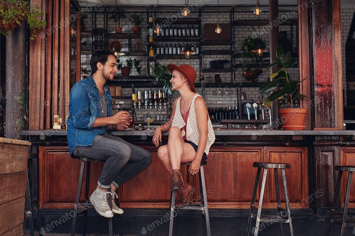 Young couple sitting at cafe counter