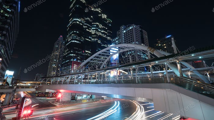 Road and pedestrian overpass in night Bangkok
