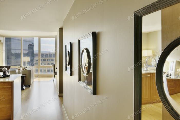 Framed Mirrors on Wall of Upscale Home Interior