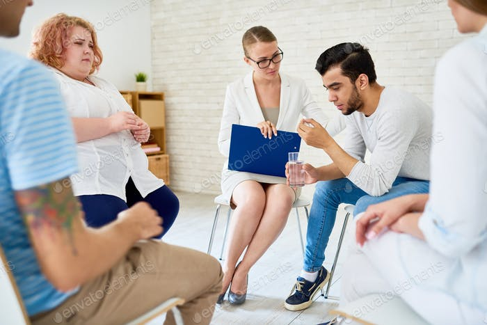 Young Man Opening Up in Group Therapy Session