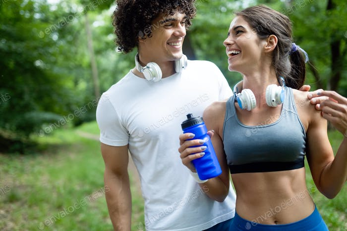 Happy couple running and jogging together outdoor