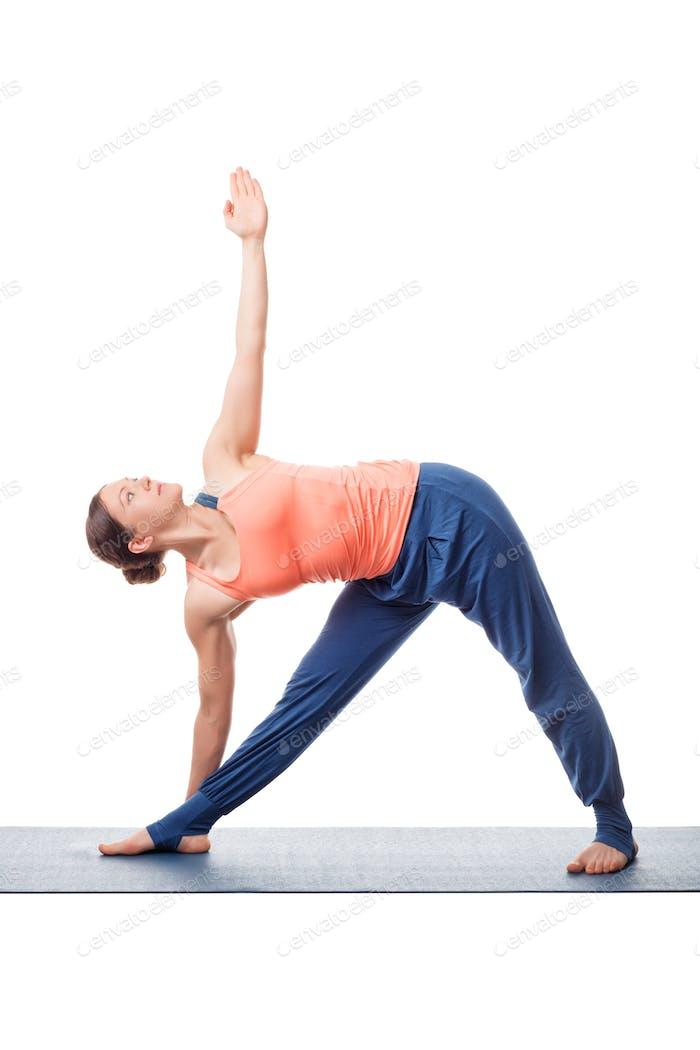 Woman practices yoga asana utthita trikonasana