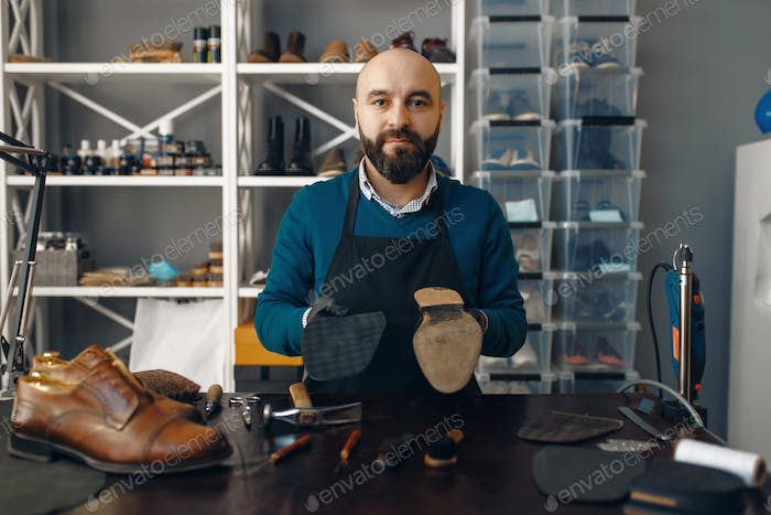 Bootmaker repairing the shoe, footwear repair