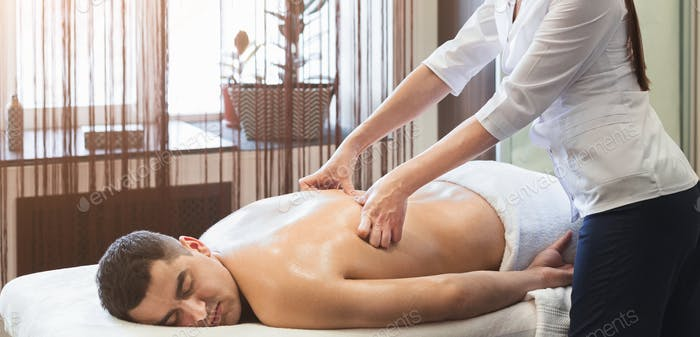 Thumbnail for Woman massaging male shoulders and back